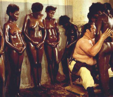 White man embrace nude black woman, with four nude black women looking on